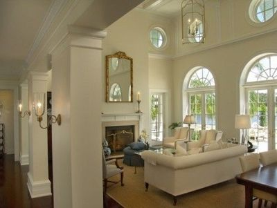 sconces on columns, furniture arrangement around fireplace / For