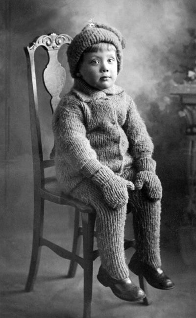 ::::::::::: Vintage Photograph :::::::::: Oh my goodness! This little one is literally covered from head to toe in a hand knit outfit. He or she (can't tell with all that fur) looks like a fuzzy little bear.