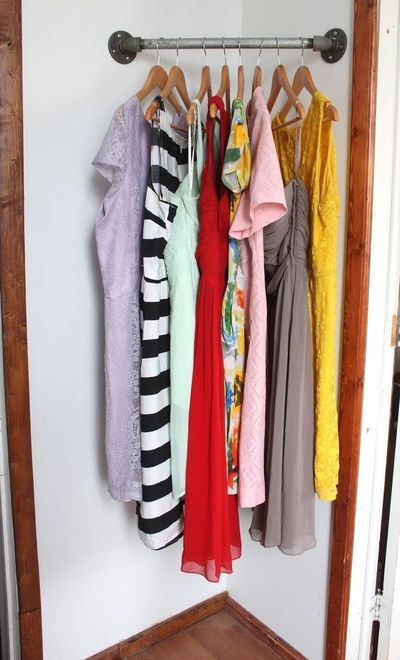Using $15 of piping from the hardware store to create a DIY Corner Clothes Rack for extra storage