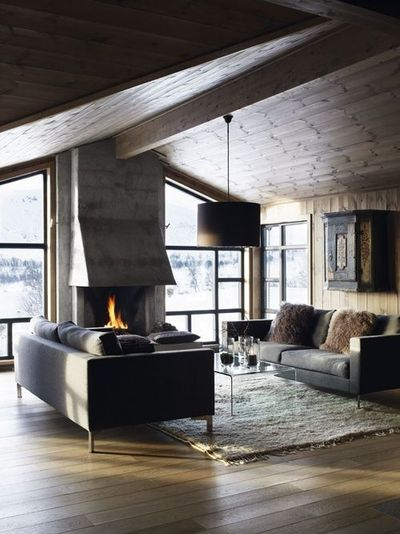 Living room / wooden floor and ceiling / cream rug / grey sofas / fireplace