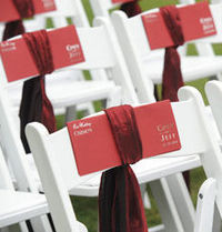 Sash holds the program on chair great for windy outdoor weddings