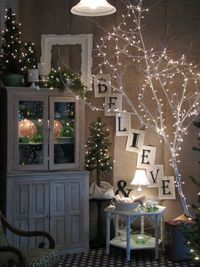 Spray paint tree branches and add twinkle lights!