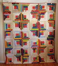 Superb scrappy quilt from Life Under Quilts.