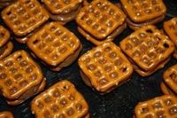 Waffle Pretzels with melted Rolos in the middle from