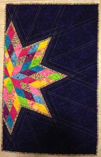 My scrappy lone star quilt in purple.