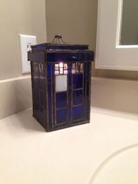 fashionistageek: The stained glass TARDIS candle holder my friend built me with a candle in it. :)