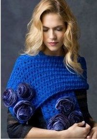 #AllFreeCrochet Sparkle in the evening with the Shimmering Blue Rose Wrap. Hints of metallic thread are twisted into the Red Heart Yarn to create a shimmer effect. Crochet roses and attach them to create an elegant accessory. So Pretty