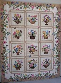 """poster wrote, """"I have been working on the quilt for several of years. I only have the flowers on the border to go."""""""