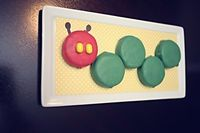 Another great Very Hungry Caterpillar idea... chocolate covered Oreos! #veryhungrycaterpillar #oreos #chocolate