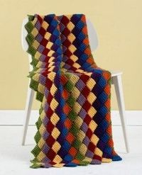 If you know how to crochet a blanket then this Tunisian Entrelac Throw should be next on your list. The colors complement each other nicely and it'll look amazing in your home.