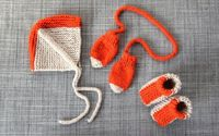 knitted creamsicle baby hat, mittens and booties