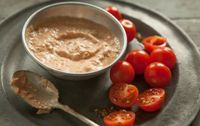Grilled Tomato and Tahini Dressing // This combination of sweet-and-smoky grilled tomatoes with nutty tahini makes a terrific dressing for salads, but try it over grilled vegetables or grilled fish or poultry, too! #recipe #summer