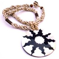 Beautiful Beaded Strung in Black Beades with Round shell Pendant self STAR designed or painted Pendant look awesome & craftsmanship on Pendant which look stunning New & unique style which look classic ethnic traditional & so stunning !!. Perfe...