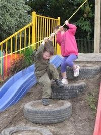 climbing tires hill rope climb slide on dirt outdoor play area