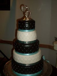 DIY Wedding Cake one woman made. Gorgeous! Chocolate bown, ivory, and tiffany blue.