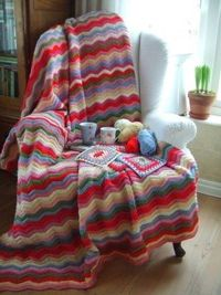 love the colors. so cozy and bright looking-really interested in the granny square potholder....