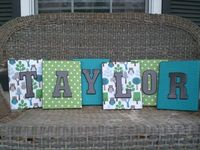 Cover canvas with scrapbook paper then painted wood letters.