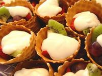 Waffle Cone Fruit Cup with Vanilla Yogurt. What a great party idea! Portable and yummy