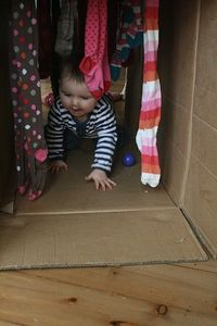 Cardboard Box Play Tunnel- in so doing this with strips of fabric!