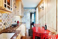 Small kitchen in a Paris apartment. Notice how the cabinets are narrowed to allow space to pass the table.