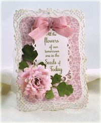 A gorgeous, feminine card from Debbie Olson. She has used coffee filters to create her flower!