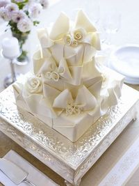 Ribbon and bow cake~White chocolate wrapping with chocolate ribbons, bows and flowers.