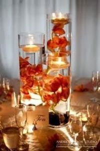 definitely want centerpieces like this with flowers and floating candles in vases