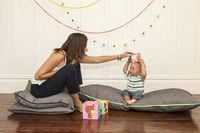 These z-pillows look perfect for a playroom or family room. Love the neon zippers!