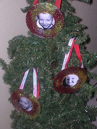 cd ornament - ribbon, glitter - picture in middle? Or just decorate to look like a bauble.