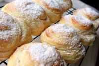 Mallorca * 1 pkg dry yeast * 3/4 cup white sugar * 4 to 5 cups all purpose flour, divided use * 1 cup milk, lukewarm * 1 cup water, lukewarm * 6 egg yolks * 1/2 lb. butter, melted and cooled to lukewarm In a mixing bowl, pour lukewarm milk and water, spri...