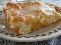 EASY REFRIGERATED CRESENT ROLL CHEESE DANISH 2 cans ready to use refrigerated crescent rolls 2 8-ounce packages cream cheese 1 cup sugar 1 teaspoon vanilla extract 1 egg 1 egg white GLAZE: 1/2 cup powdered sugar 2 Tablespoons milk 1/2 teaspoon vanilla ext...