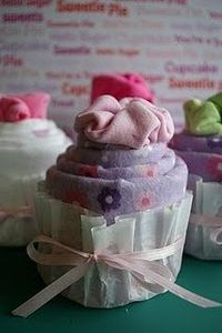 Baby Onesie Cupcakes: 4 receiving blankets, 4 onesies, 4 rubber bands, 4 coffee filters, & ribbon..