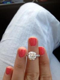 3 carat colorless, flawless, cushion cut center stone, 3 sided mico pave diamond band. STUNNING!