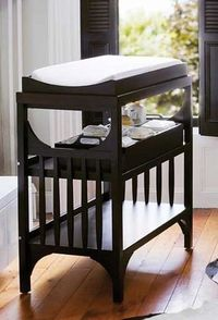 changing table! I love the dark wood.