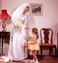 1961: A portrait of a bride with a little bridesmaid who is wearing a matching yellow dress Photo: Popperfoto, Getty / Popperfoto