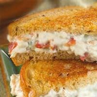 "Bacon & Blue on Rye - Smooth cream cheese and tangy blue cheese mixed with Italian dressing are the center of this ""all-grown-up"" grilled cheese sandwich."