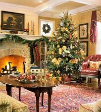 This rug is to die for and goes perfectly with the yellow walls, the furniture and the tree ornaments. The fire just gives off a glow.